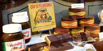 "A picture shows a window shop displaying Nutella products (L) and the old pot of ""Supercrema"" the former Nutella of the Ferrero brand on May 17, 2014 in Alba, northern Italy, during the celebrations of the 50th anniversary of Nutella, the chocolate hazelnut spread made by Ferrero. The first pot of the addictive mix was made in Alba in northwest Italy in April 1964. The anniversary celebrations begin in Alba and events are also being planned in 50 countries, including Canada, Germany, Russia and the United Arab Emirates, ending with a concert in New York on Monday.  AFP PHOTO / GIUSEPPE CACACE"